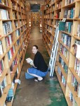 Jenny in Powell's Books in Portland, OR, with Number9Dream in hand