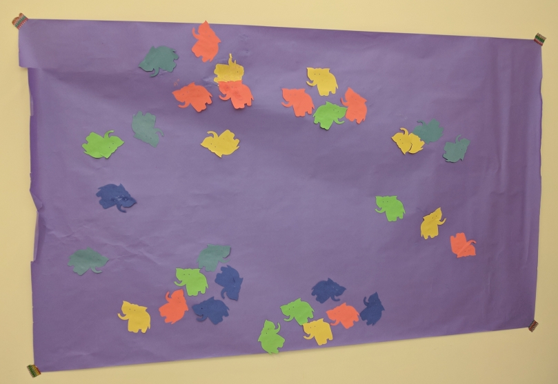 Purple paper with multicolored elephants