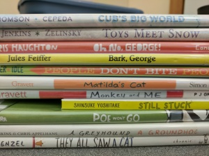 Picture books piled up for storytime