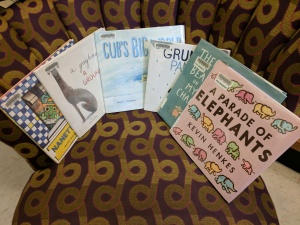 Picture books face-out on a chair