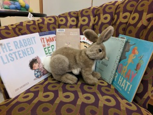 Rabbit puppet and six picture books on the storytime chair