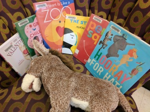 Picture books on a chair with a donkey puppet