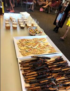 Snack table with pretzel wands, lightning bolt sugar cookies, jelly beans, and butterbeer