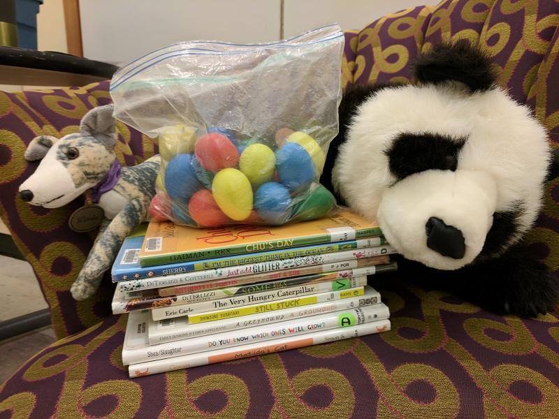 Books, shaker eggs, greyhound and panda stuffed animals
