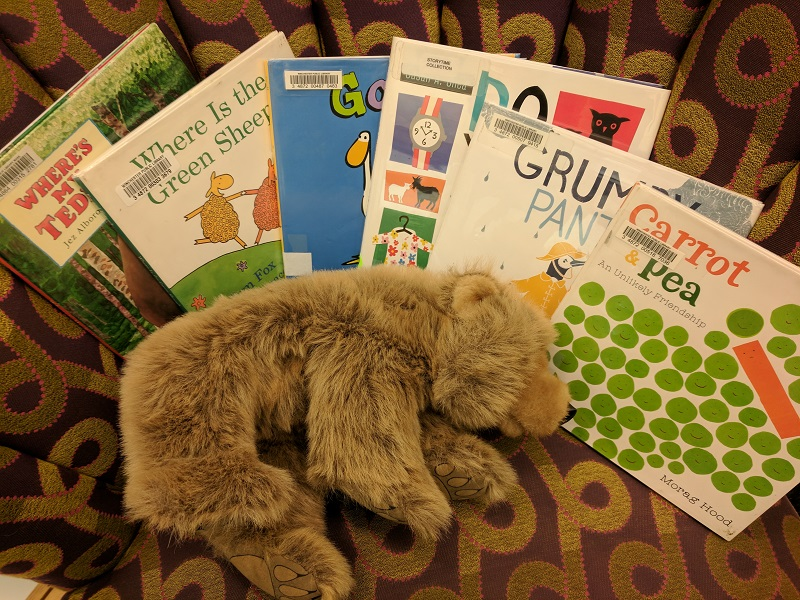 Picture books and bear on chair