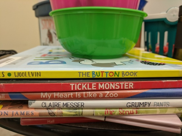 Storytime books with bowls of crayons