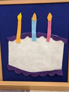 felt birthday cake and three candles