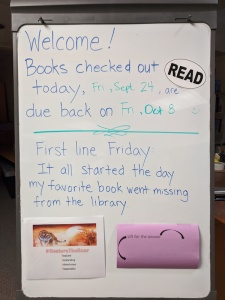 Whiteboard with date, due date, and First Line Friday quote from Ban This Book